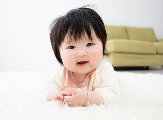photo of a baby girl on a carpet